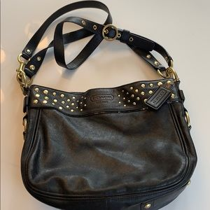 Black leather with gold studs. Authentic Coach.